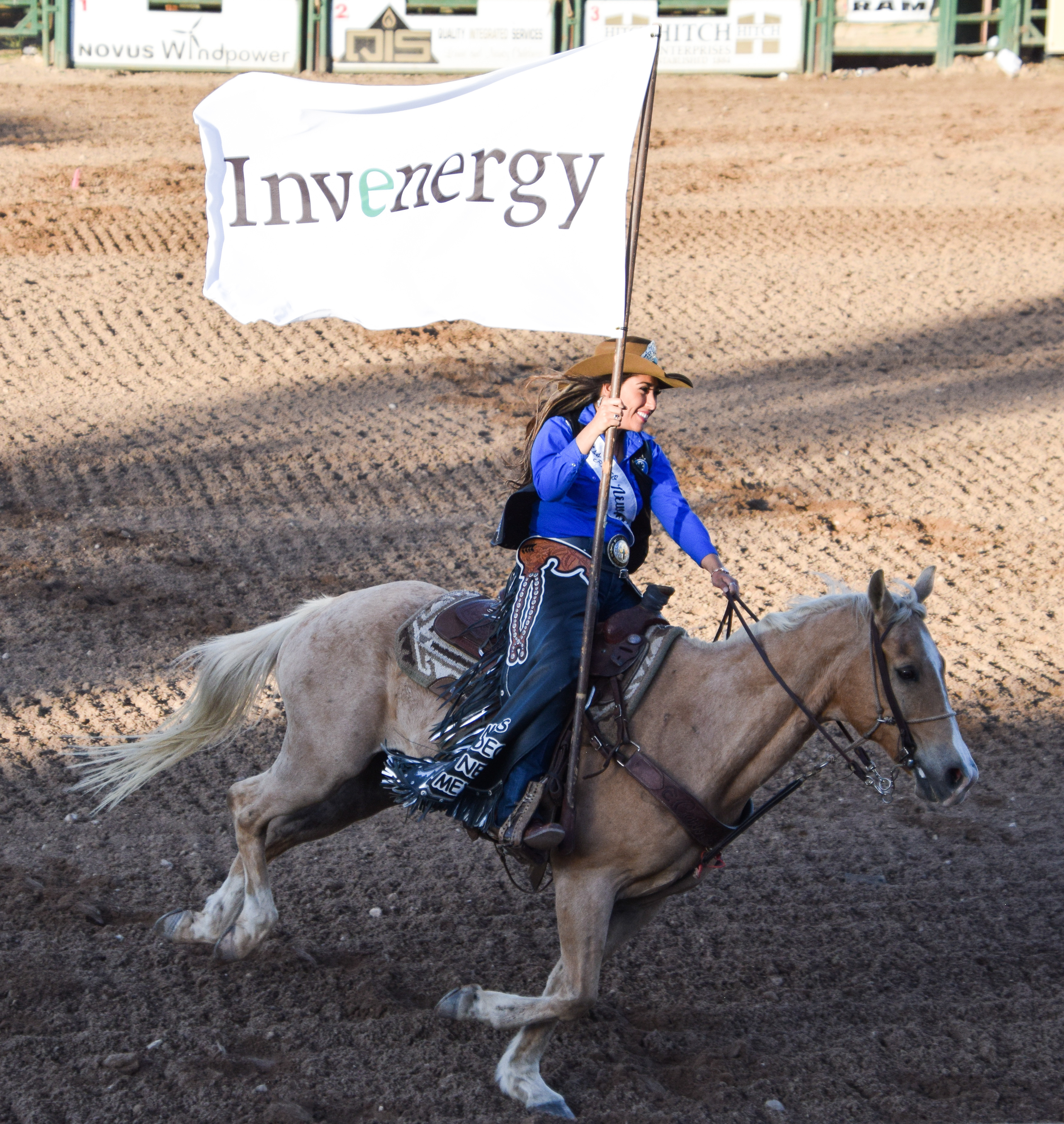 Rodeo-Queen-carrying-the-Invenergy-sponsor-flag.jpg#asset:1989